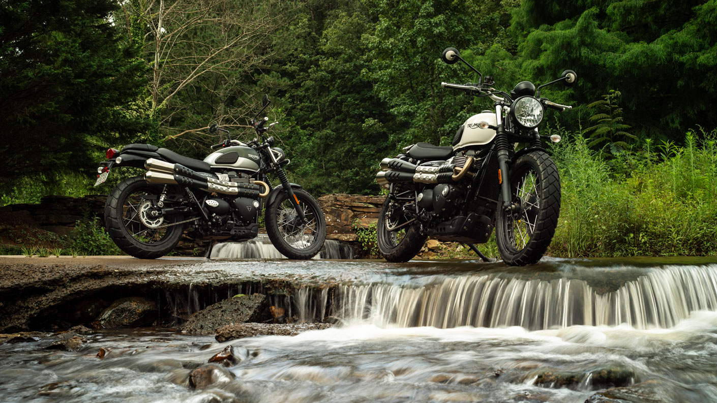 2 Triumph Street Scramblers parked next to waterfall
