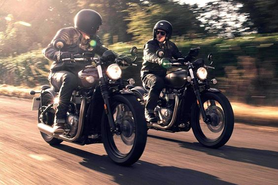 two Triumph bonneville bobbers riding side by side