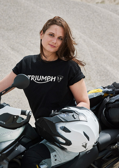 Lea Rieck in black Triumph logo t-shirt sat on a Triumph Tiger 800 XCA