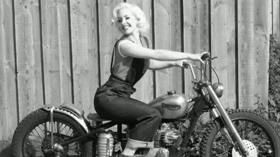 Retro image of lady on a old Triumph Motorcycle