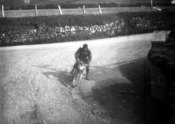 Historic rider on a dirt track