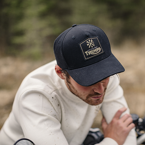 Triumph's collaboration with Bike Shed carpe terram cap in black with gold detailing