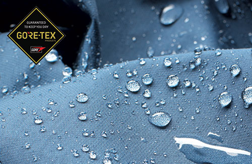 Triumph Gore Tex garment with water droplets covering the surface with Gore Tex logo overlay
