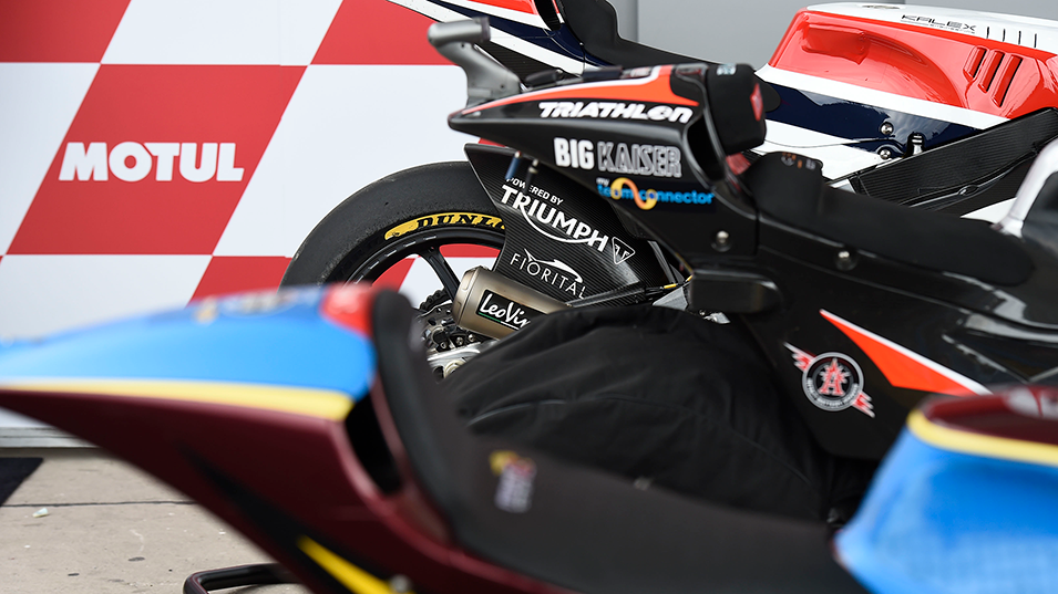 Fleet of Moto2 motorcycles ready to race in the second leg in Argentina, featuring Triumph branded swingarm