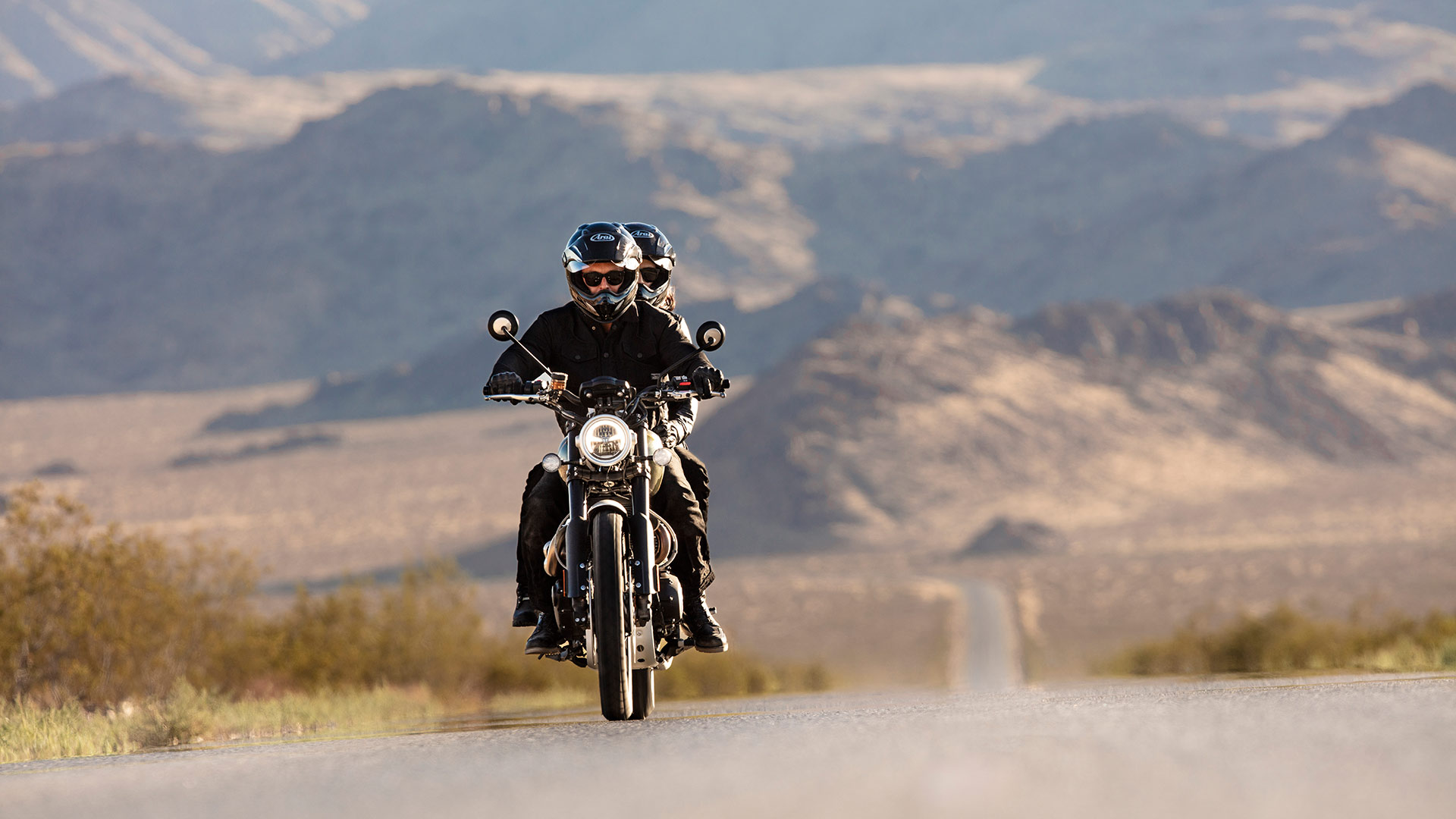 A rider on the Triumph Scrambler 1200 riding along a scenic route
