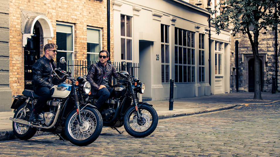Triumph Bonneville T100 and T100 Black Stationary in cobbled courtyard