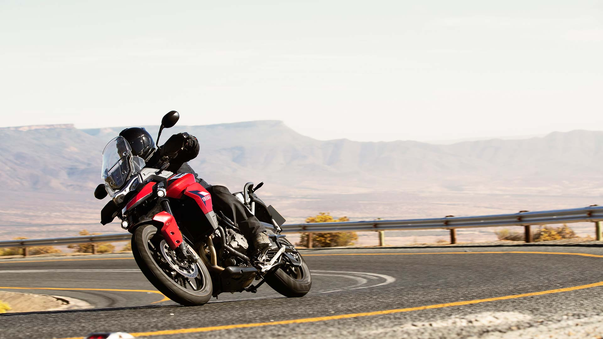 Triumph Tiger 900 GT Pro in Korosi Red powering through the corners of South Africa