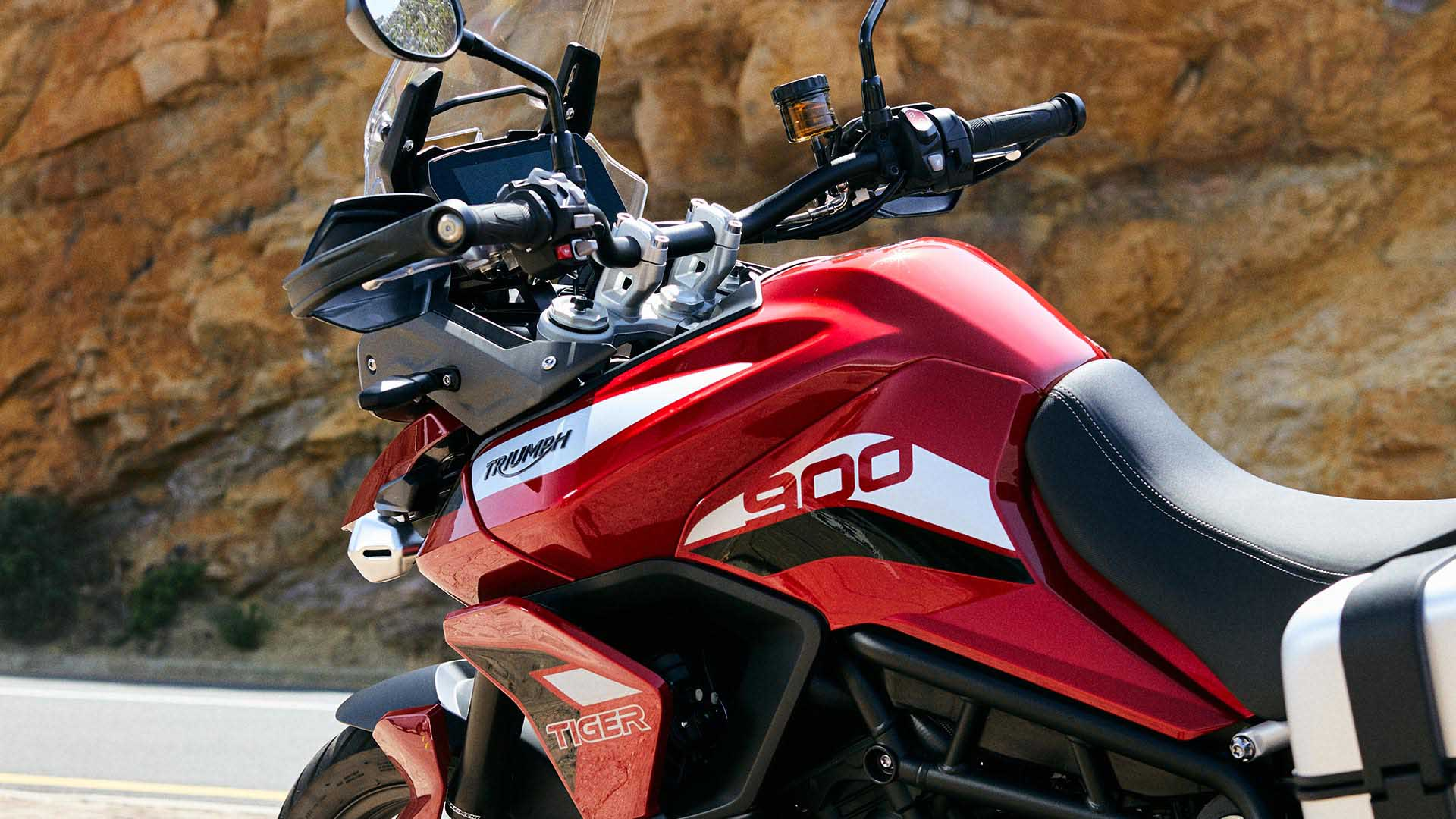 Close-up shot of Triumph Tiger 900 GT Pro in Korosi Red
