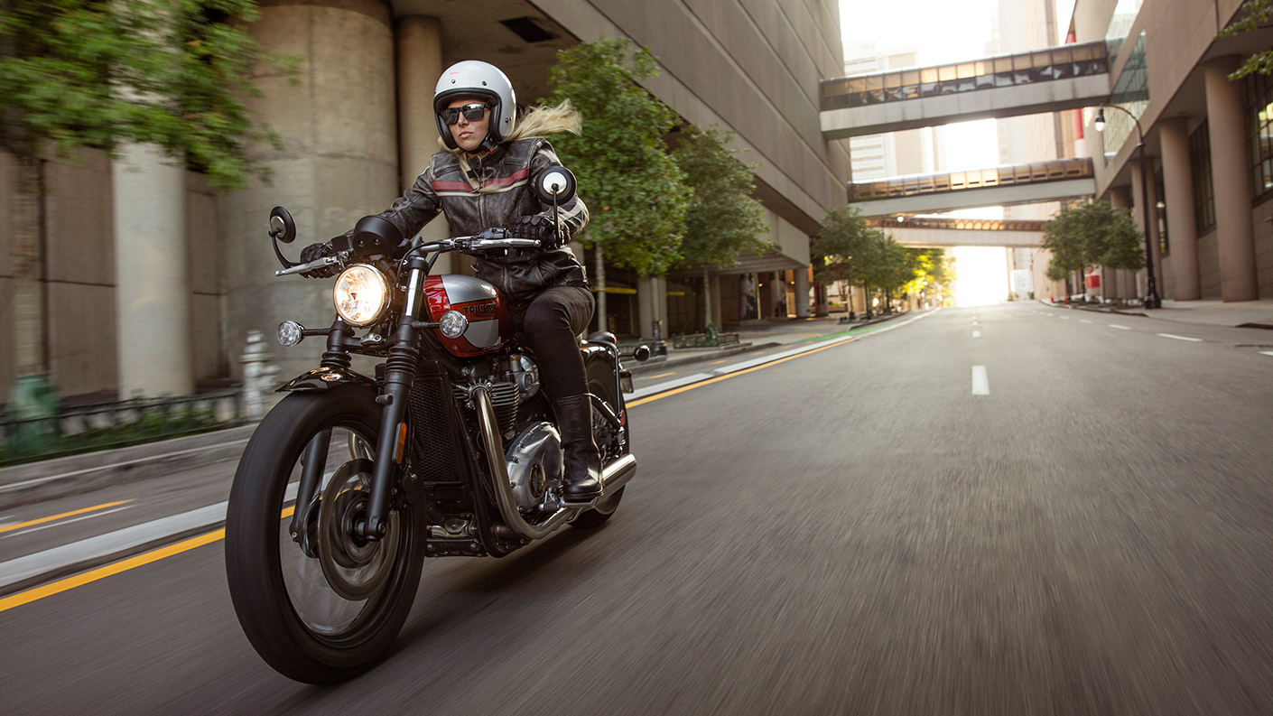 Person riding a Triumph Bonneville Bobber