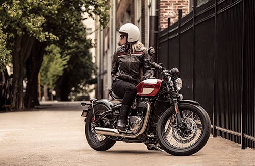 person sitting on Triumph Bonneville Bobber