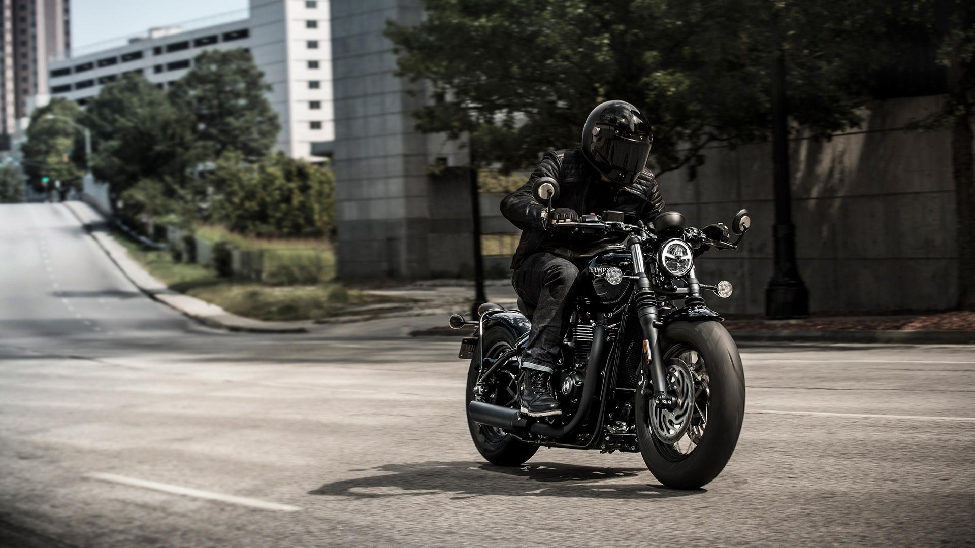 Person riding a Triumph Bonneville Bobber Black