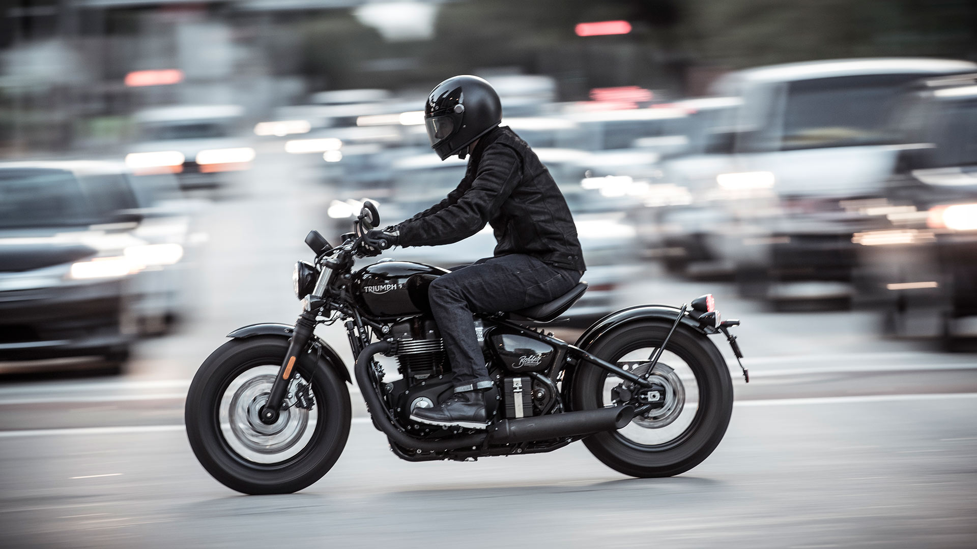 Person riding a Triumph Bonneville Bobber Black