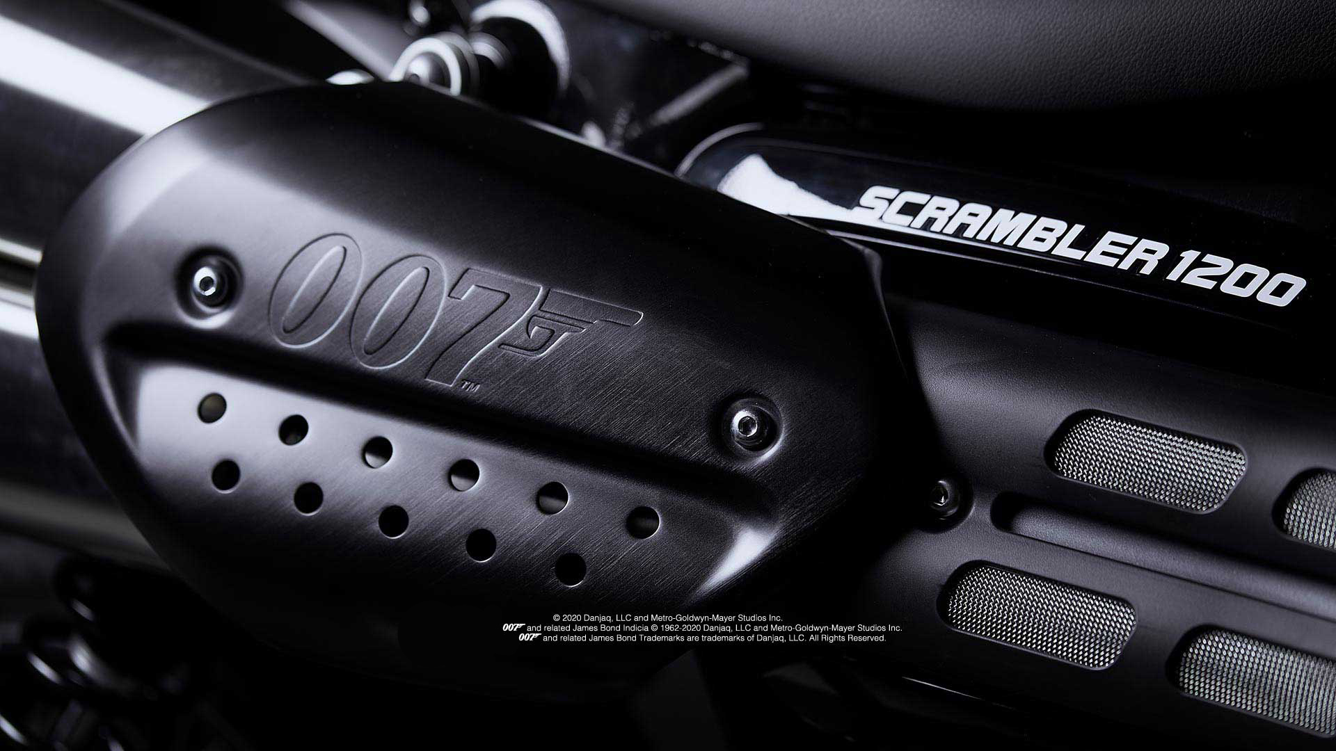 Close up of the Triumph Scrambler 1200 Bond Edition exhaust number board with pressed 007 branding
