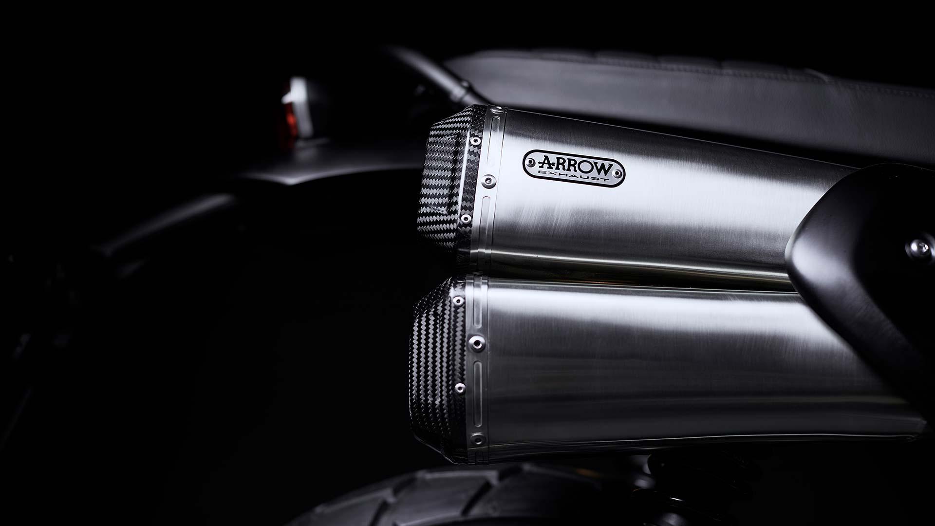 Close up of the Triumph Scrambler 1200 Bond Edition Arrow silencer with carbon fibre end caps