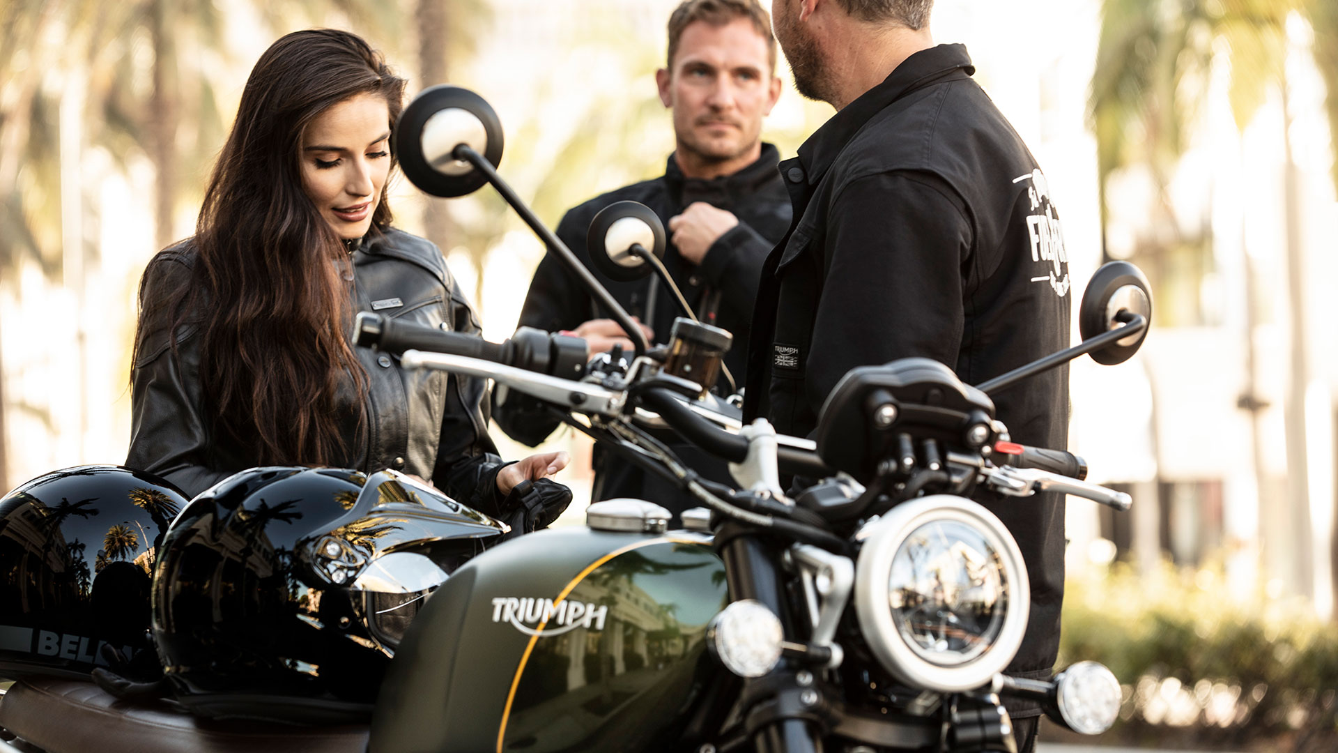 Three riders congregating around the brand new Triumph Scrambler 1200 XC