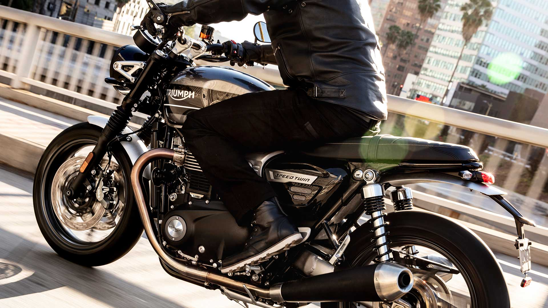 Triumph Speed Twin riding through the city wearing black Triumph Stoke boots