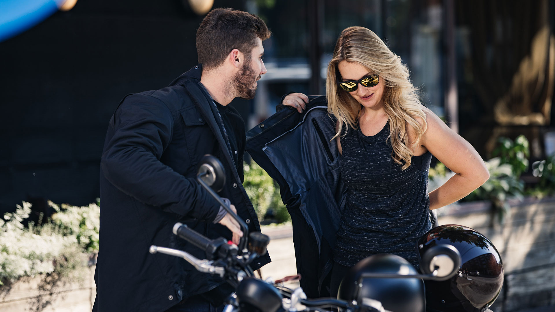 Couple behind a Triumph Street Twin wearing Triumph clothing