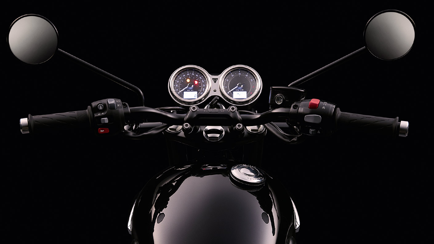 Triumph T120 black motorcycle twin clock