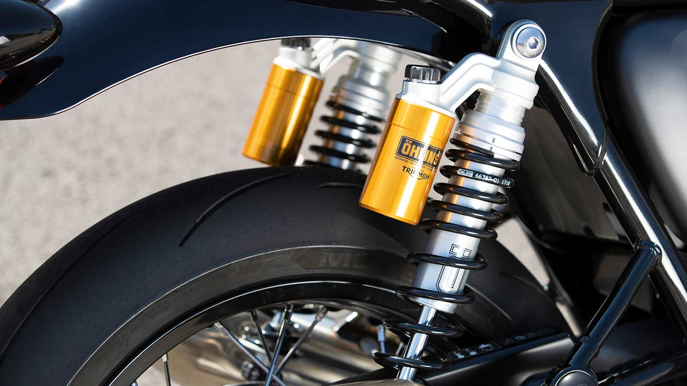 Close-up shot of the Triumph Thruxton RS's fully adjustable Öhlins rear suspension