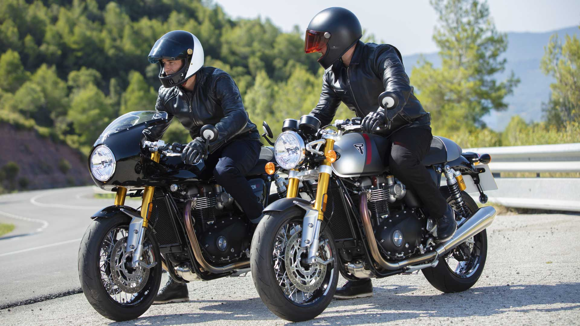 Shot of the two Triumph Thruxton RS motorcycles in both available colour options from Jet Black or Matt Silver Ice & Matt Storm Grey
