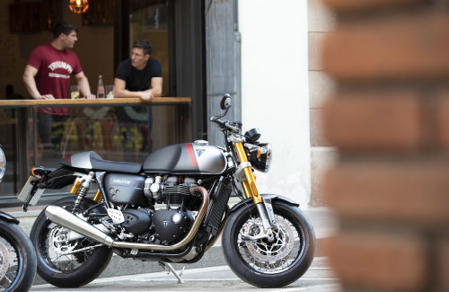 The new Triumph Thruxton RS in Matt Storm Grey & Matt Silver Ice parked in urban area
