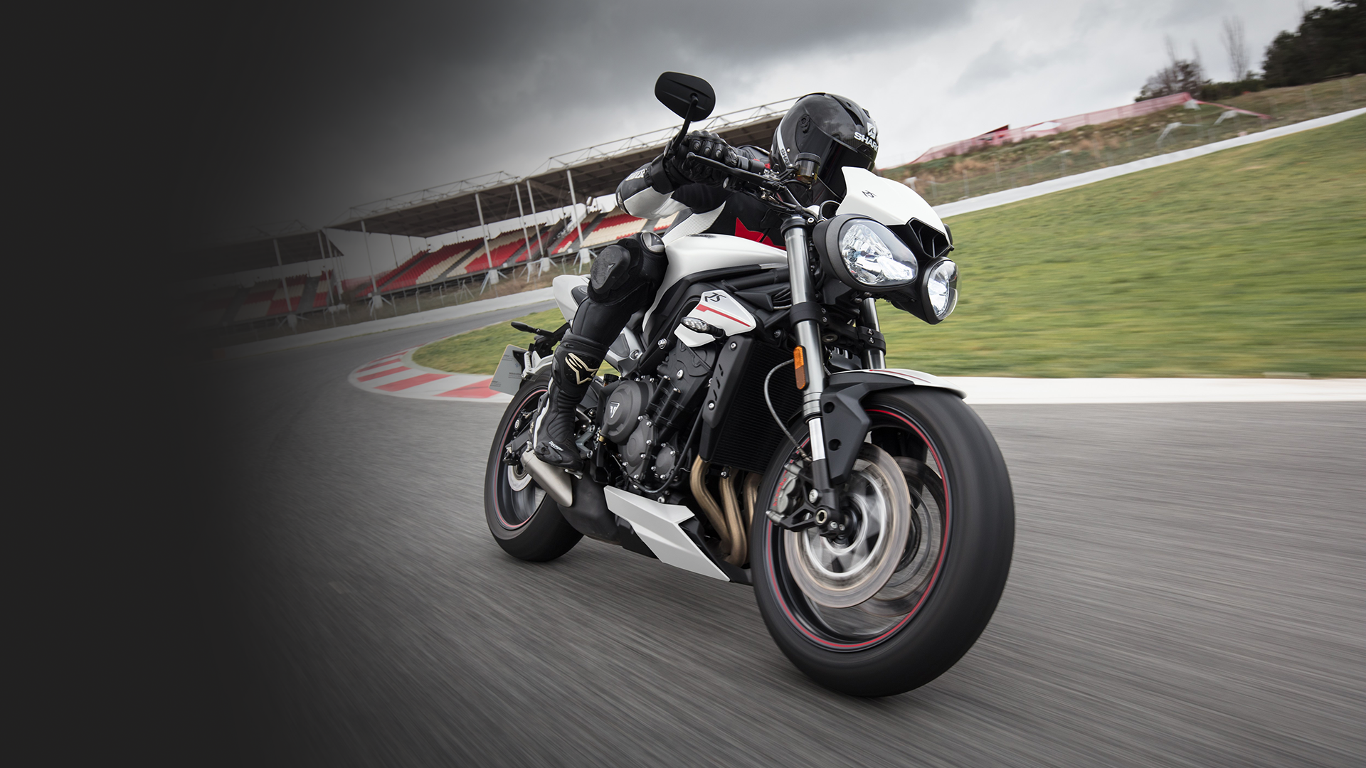 Triumph Street Triple RS in White racing on a race track