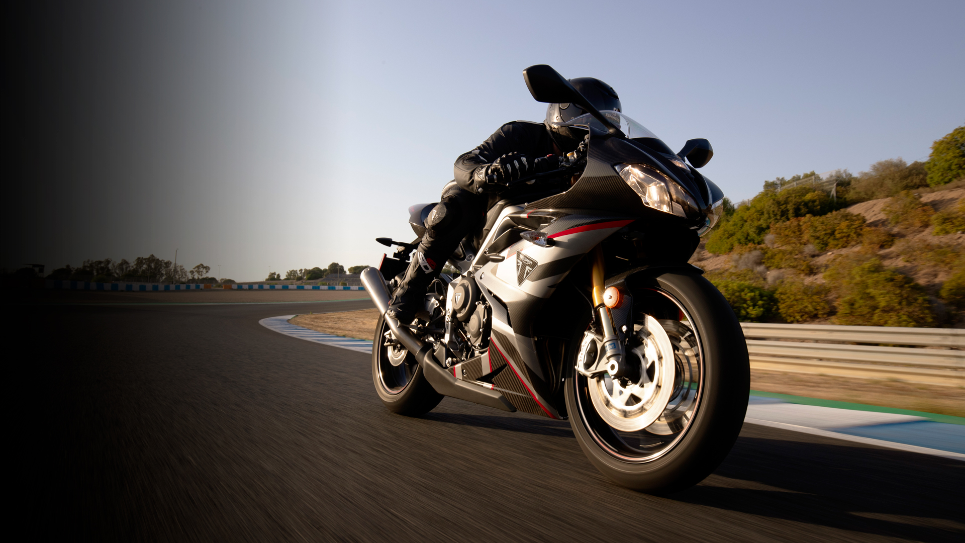 Triumph Daytona Moto2TM 765 motorcycle (USA) racing around a race track in Spain