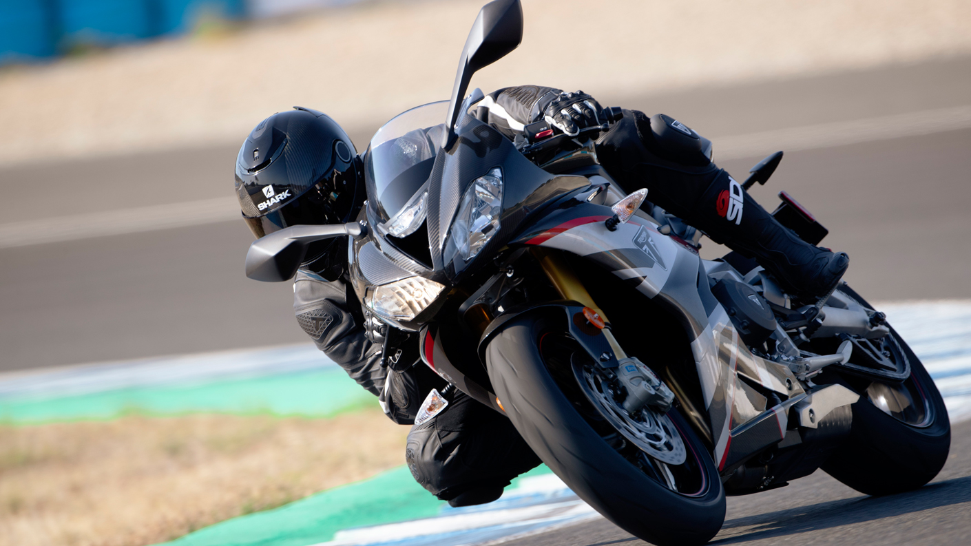 Triumph Daytona Moto2TM 765 motorcycle (USA Edition) racing around a race track at speed