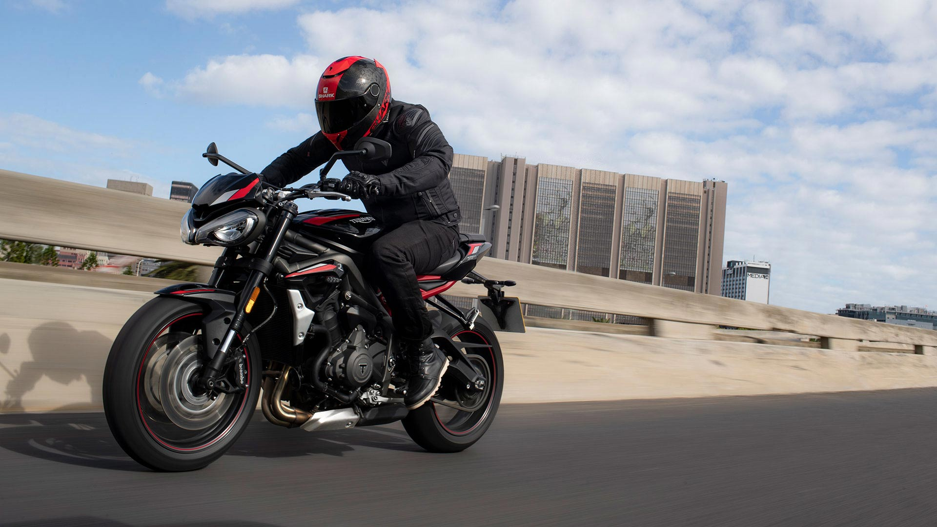 Rider on Triumph Street Triple R accelerating down motorway