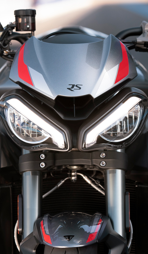 Close-up front shot of Triumph Street Triple RS in Silver Ice beautifully distinctive full-LED twin headlight