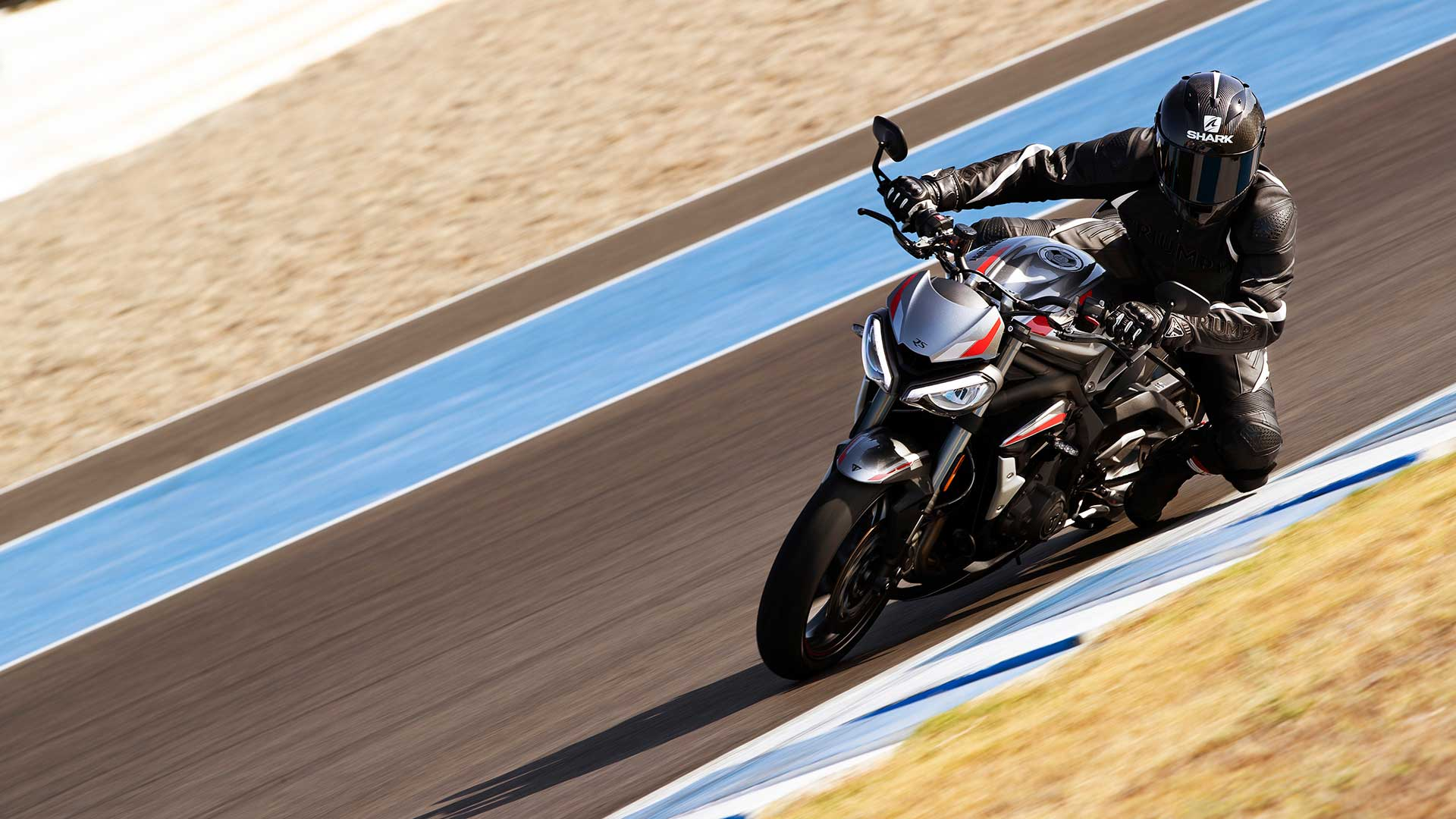 Action shot of Triumph Street Triple RS in Silver Ice  on a racetrack bend