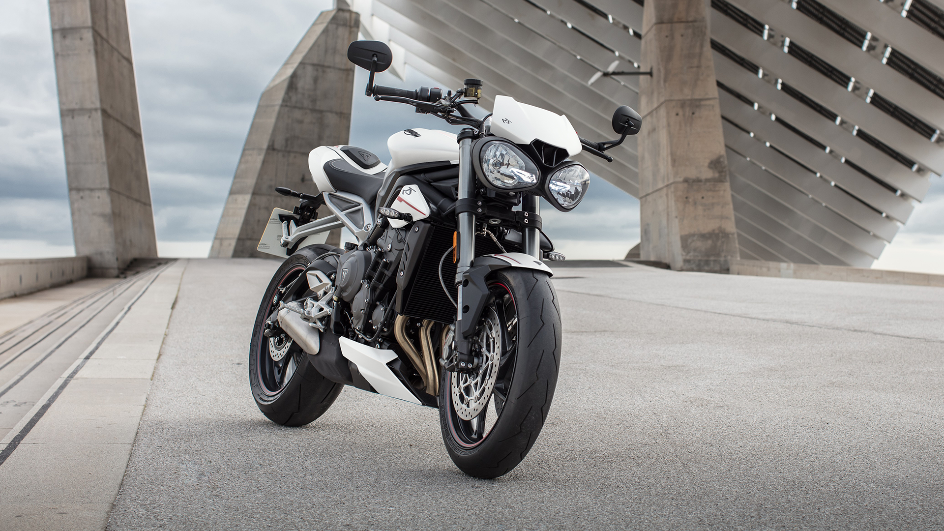 Triumph Street Triple RS in Crystal White stationary in urban setting