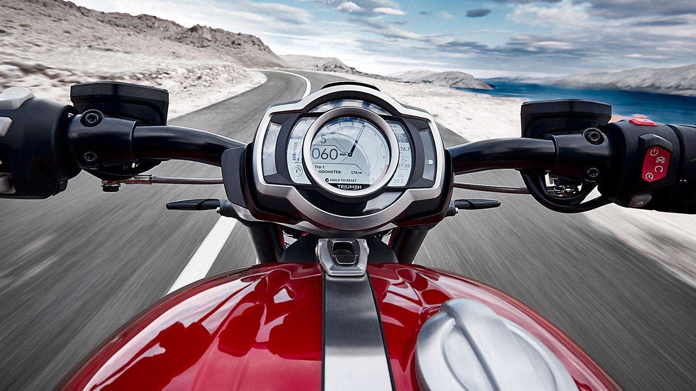 Triumph Rocket 3 point-of-view riding shot displaying accessory fit TFT connectivity system that offers world's first integrated GoPro control system