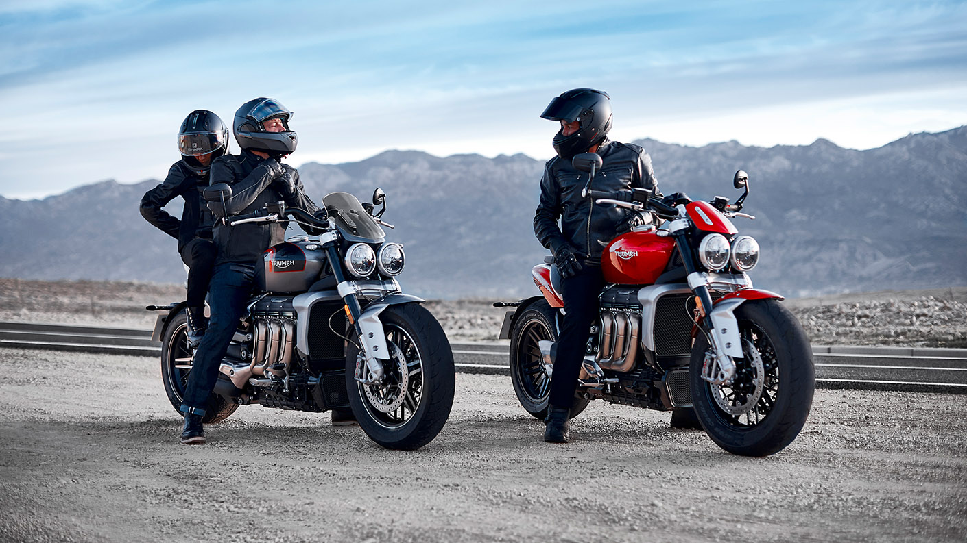 Riders stopping for a chat on their Triumph Rocket 3 GT in Silver Ice & Grey and Triumph Rocket 3 R in Korosi Red