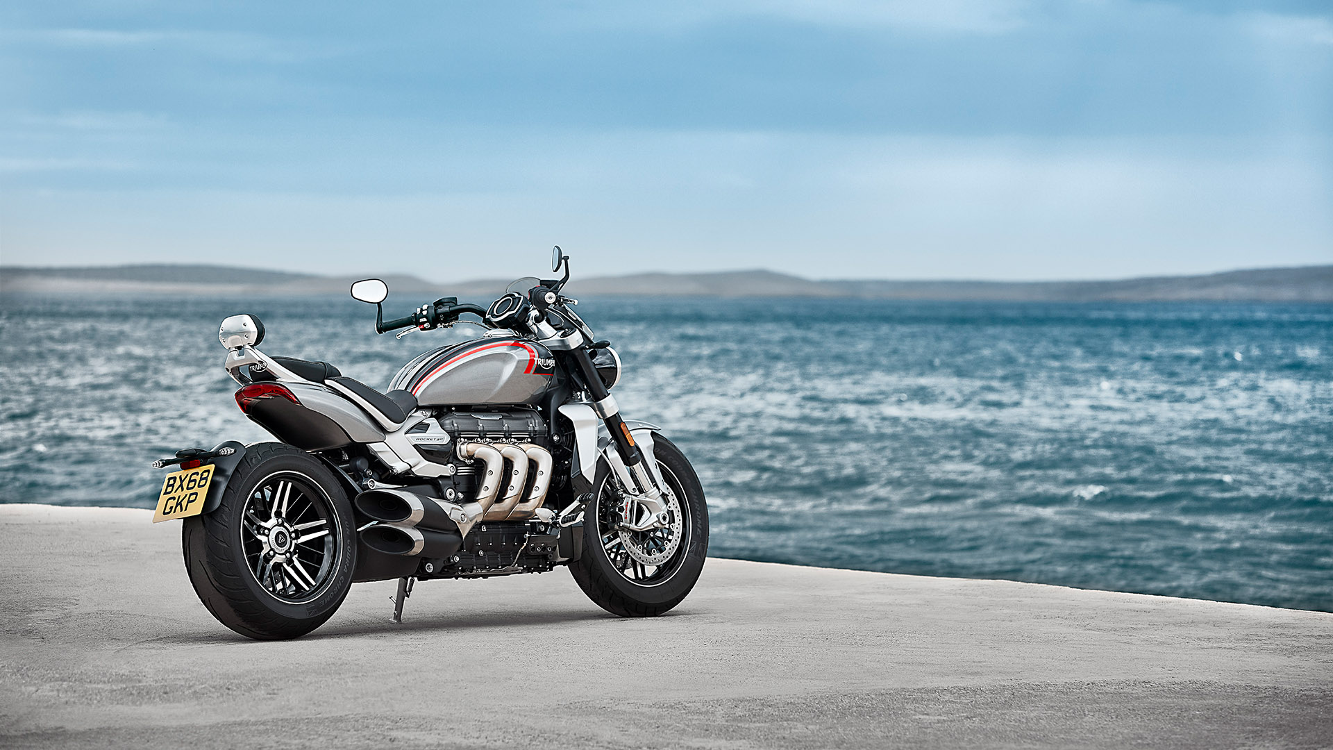 Static shot of the Triumph Rocket 3 GT in Silver Ice and stromy grey, with distictive design features