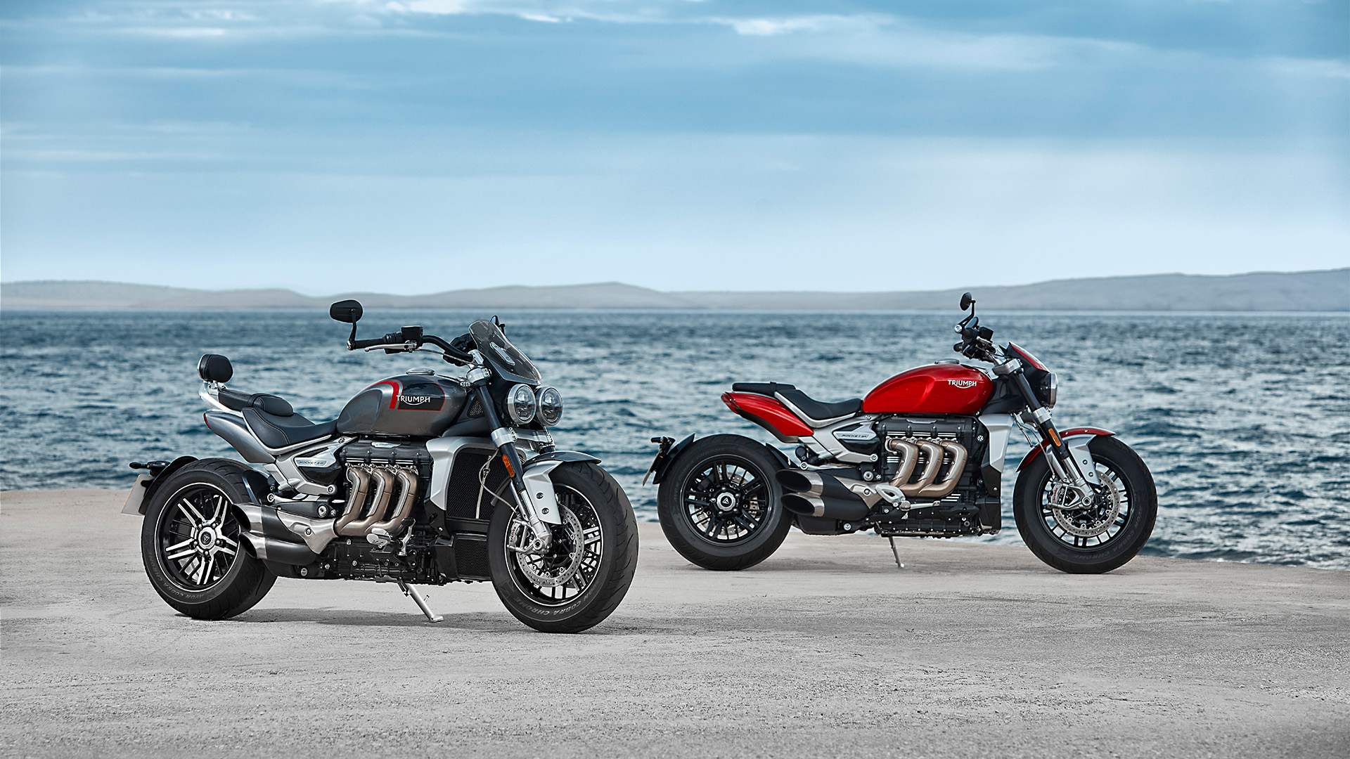 Static shot of the Triumph all-new Rocket 3 R in Korosi Red and GT model in Silver Ice and storm grey