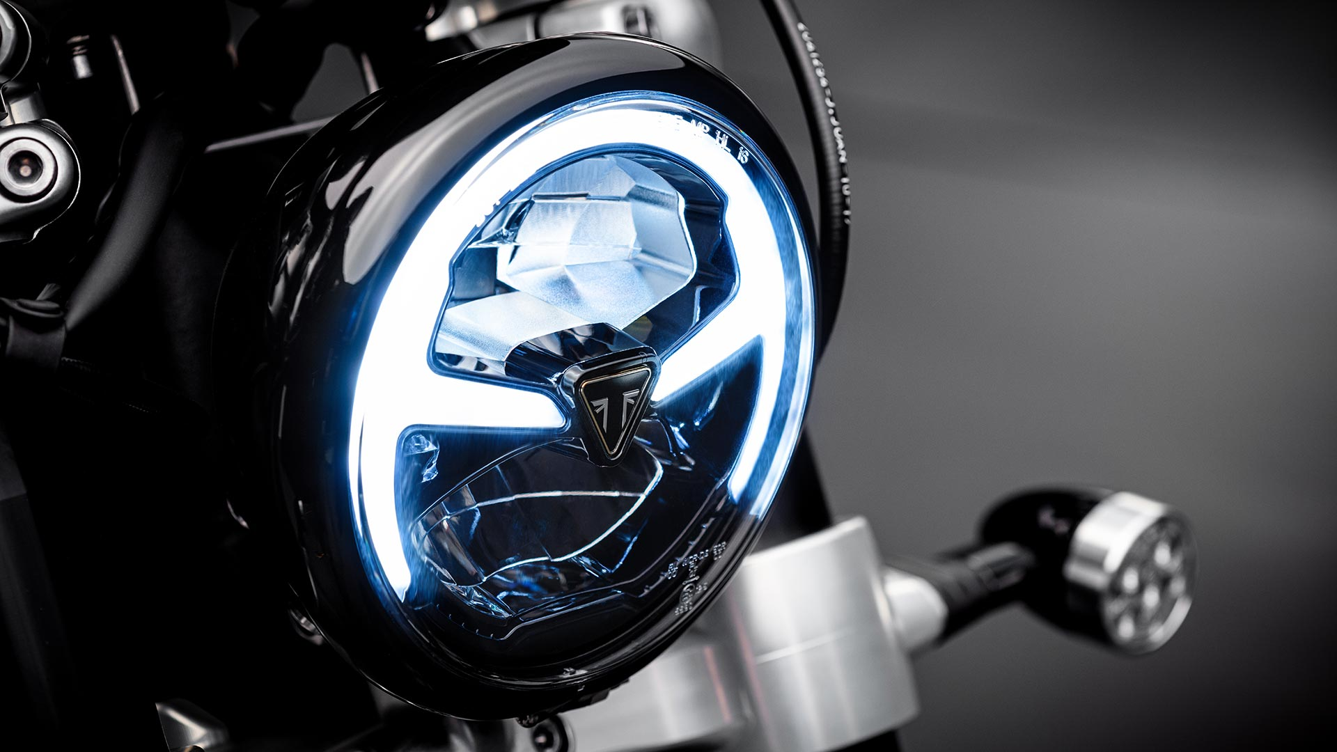 Close-up shot of the Triumph Bobber TFC's LED headlight