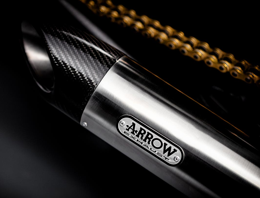 Close-up shot of the Triumph Bobber TFC's Arrow titanium silencers with carbon fibre end caps
