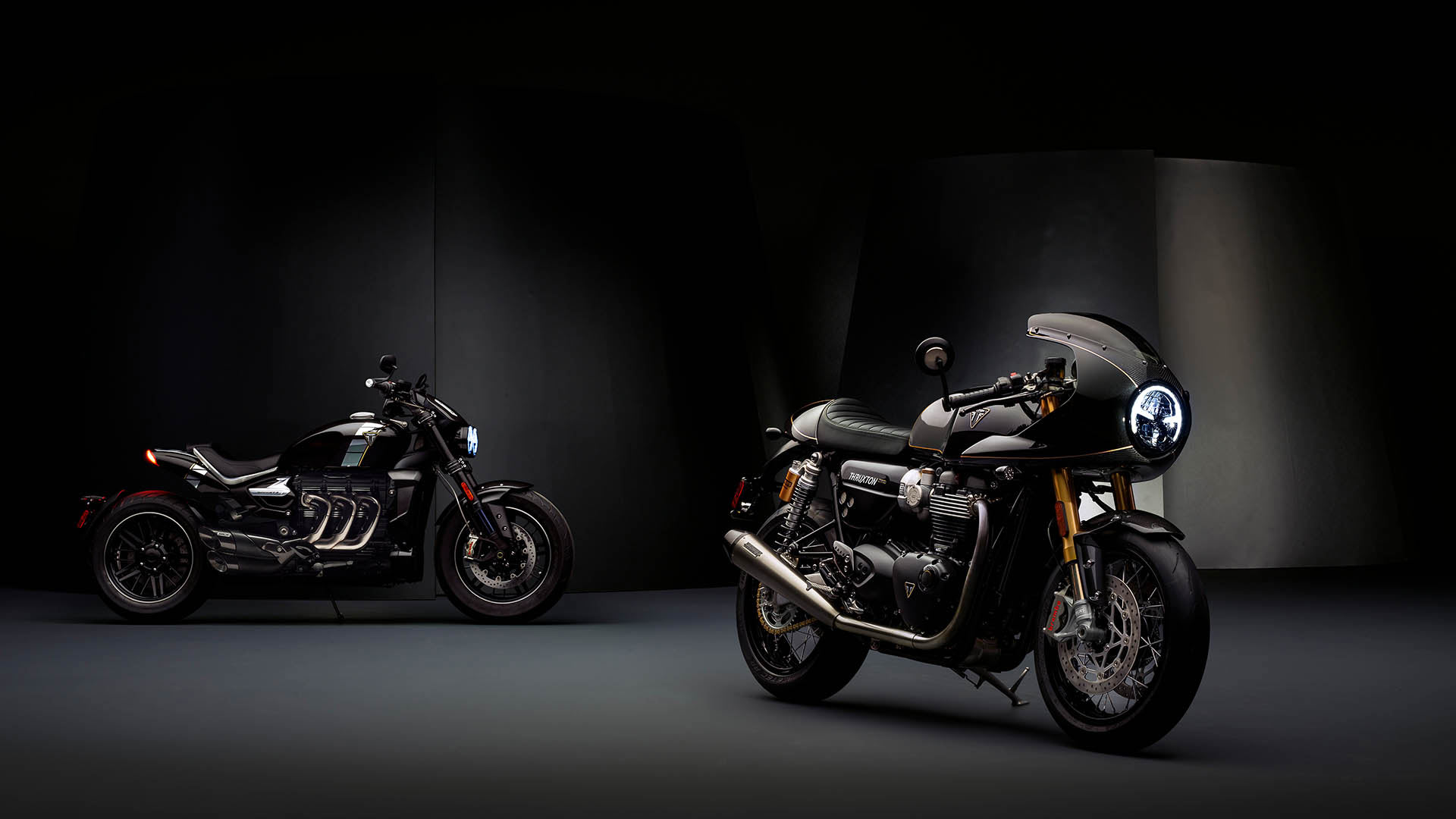 Beautiful angled shot of both the Rocket 3 TFC and Thruxton TFC