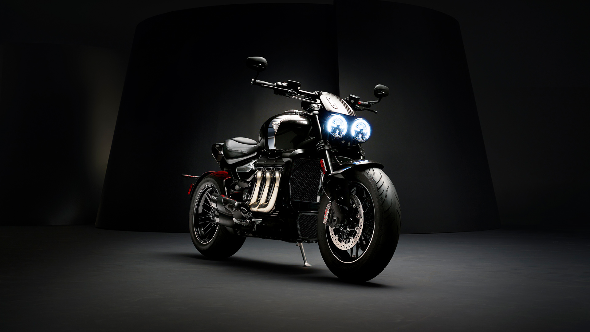 Triumph Rocket 3 TFC front three quarters featuring iconic three header exhaust run with premium carbon fibre detailing