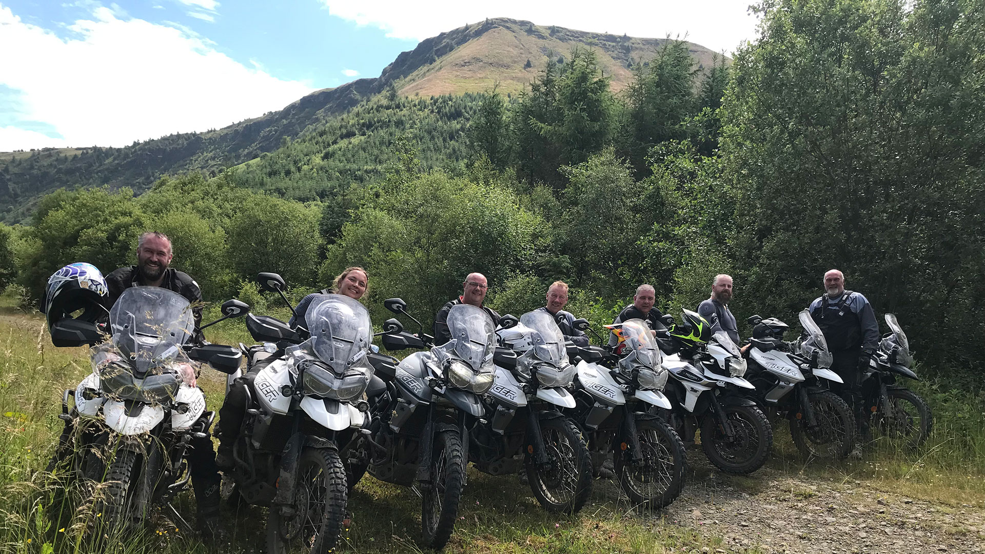 A group of riders on Triumph Tiger motorcycles during an experience day