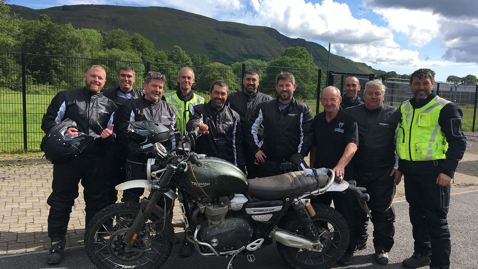 Group shot of the rider participants on the training course for riding the Triumph Scrambler 1200 XC