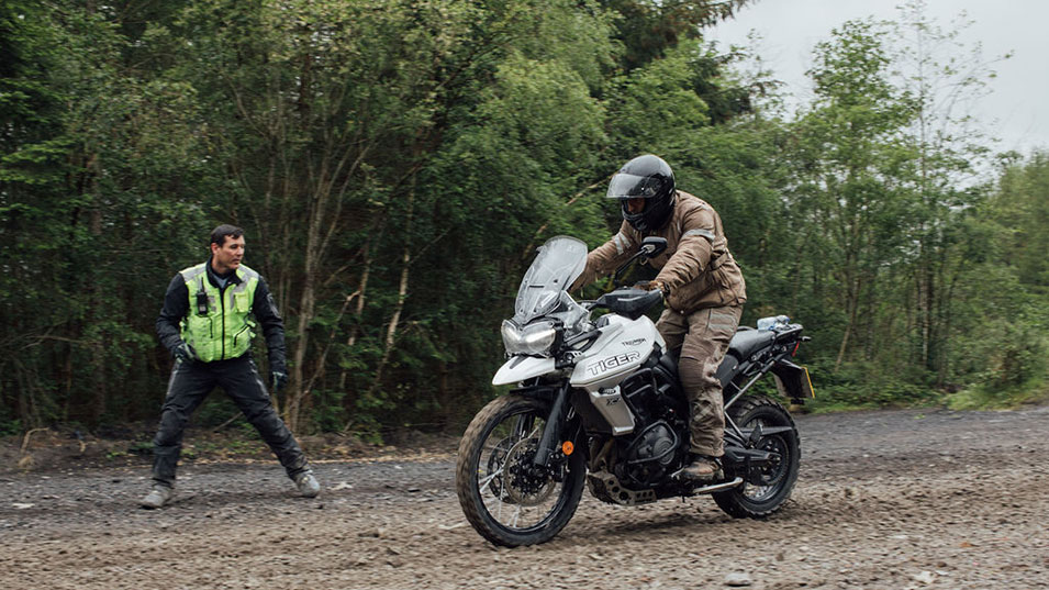Training instructor motivating the rider on the Triumph Tiger 800