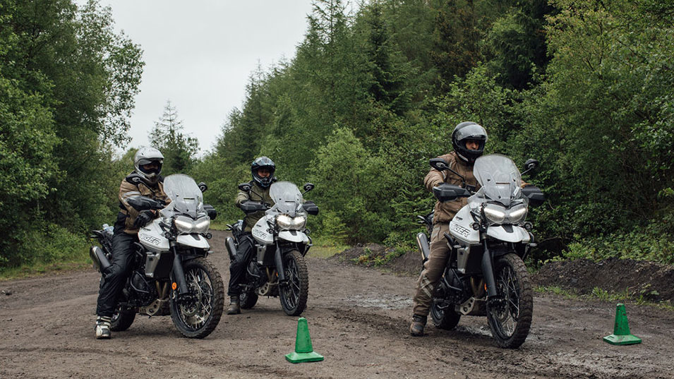 A group of riders on Triumph Tiger 800 preparing for the adventure training